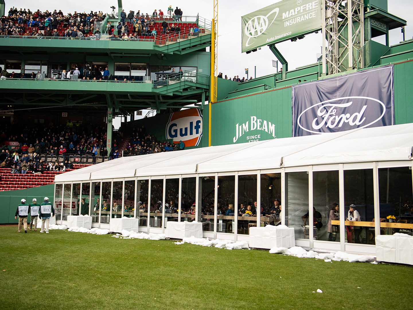 PEAK Tent set up in outfield of Fenway Park for Harvard-Yale football game